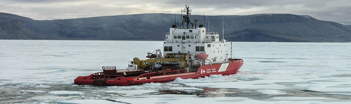 Canadian Coast Guard icebreaker clearing ice from a bay.