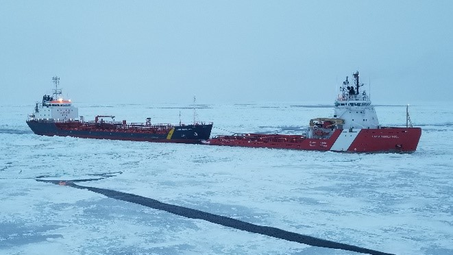 CCGS Captain Molly Kool using its unique towing notch to tow Jana Desgagnes through difficult ice conditions.