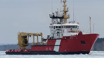 Pictured: The CCGS Samuel Risley performs icebreaking duties on the St. Marys River, Ontario in March 2020.