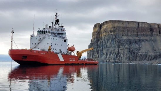 The CCGS Terry Fox on icebreaking standby in Gascoyne Inlet, Nunavut.