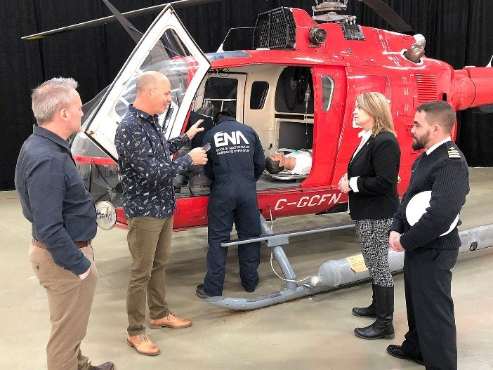 A student from École nationale d'aérotechnique demonstrates how the newly-donated BO 105 helicopter improves their learning alongside teacher, Louis Guimont.